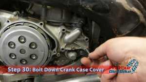 Step 30: Bolt Down crank Case Cover