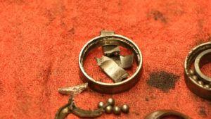 Front Wheel Bearings - Old Bearings On Towel - Closeup on Shattered Bearing-1