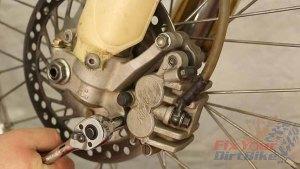 Step 1 - Unbolt the brake caliper from the fork
