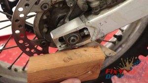 Step 4 - Knock Axle Into Swingarm