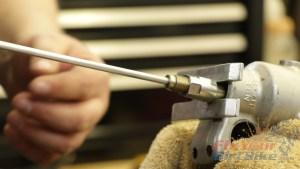 10 - Remove Rebound Adjuster Push Rod