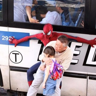 spider man saving people from the bus