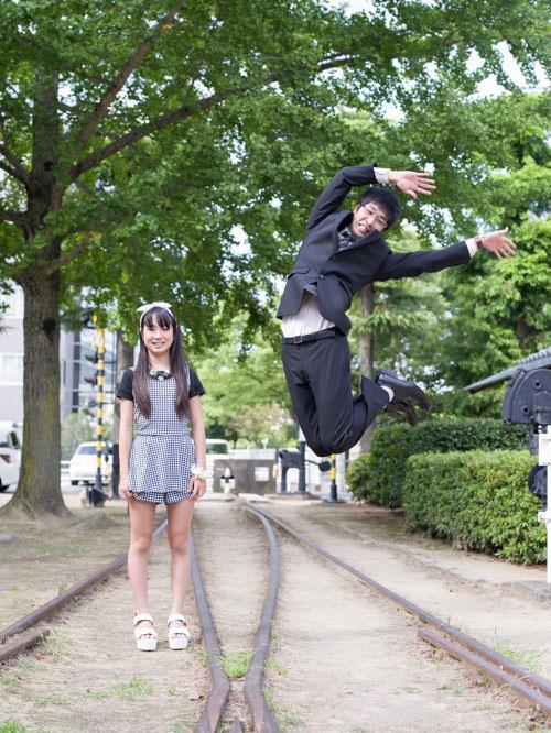 Japanese Businessmen Jumping Beside their Daughters