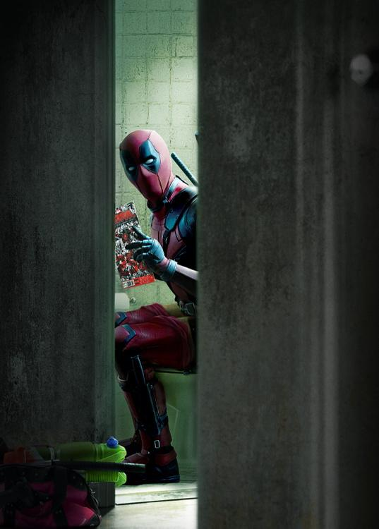 official-deadpool-photo-shows-him-reading-a-comic-on-the-can