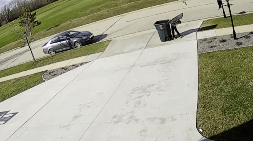 kid-tries-to-take-the-garbage-out-on-a-windy-day