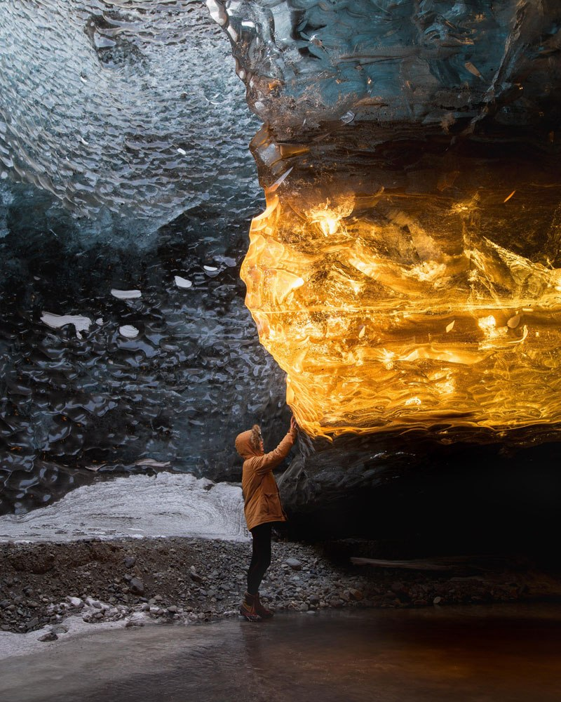 setting-sun-turns-ice-cave-in-iceland-into-amber-by-sarah-bethea