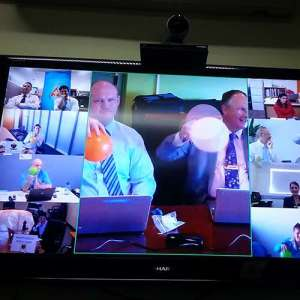 Group video calls of people holding up balloons