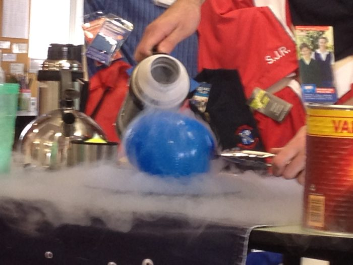 Liquid nitrogen on a balloon science experiment - pouring liquid nitrogen on a balloon during a Fizzics science show