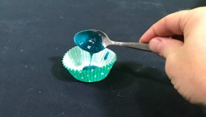 Spooning hot toffee into cupcake mould