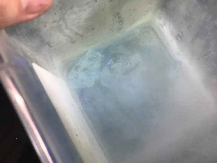 Create ice cores with dry ice experiment - dry ice stuck to bottom of container