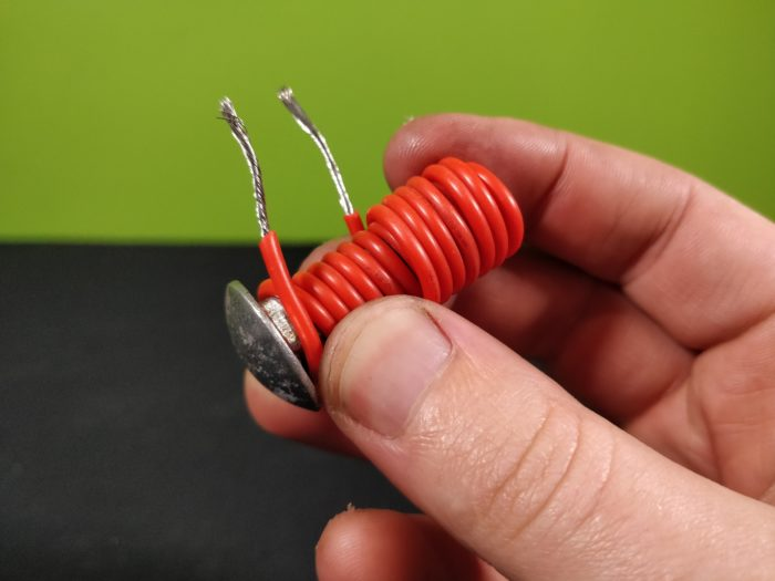 Wrapping insulated wire around a steel bolt