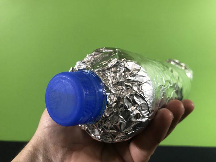 Lovely light beam science experiment - foil around water bottle cap