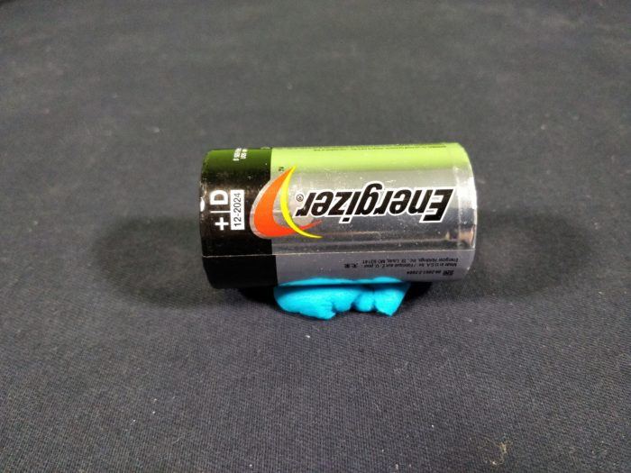 Make a Simple Motor - use playdo to make a stand for battery so that it doesn_t roll away