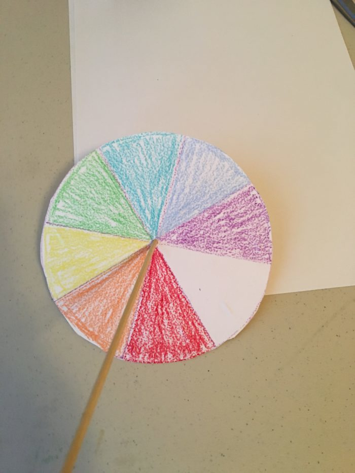 Newton colour wheel science experiment - pushing skewer through the colour wheel