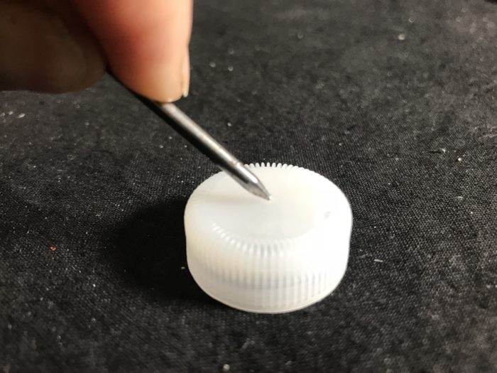 Simulate ocean currents experiment - pushing a nail through a plastic lid
