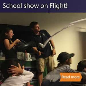 Flight school science visit tile showing a presenter and a child with a leafblower making toilet paper fly