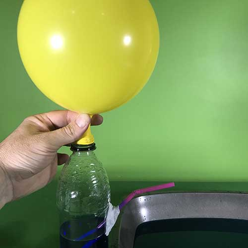 Holding a balloon on the bottle fountain