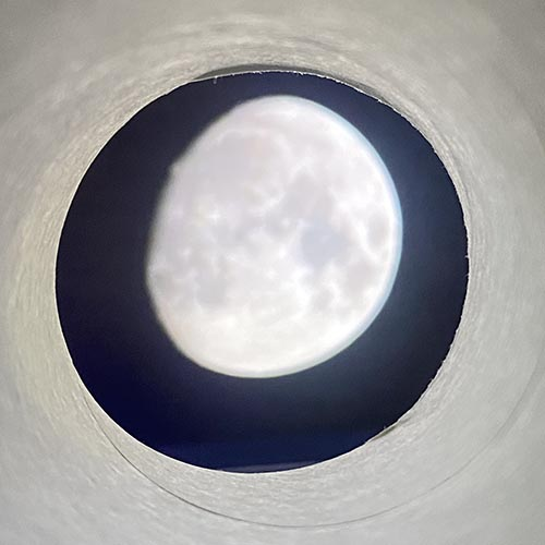 Moon shown inside a cardboard tube