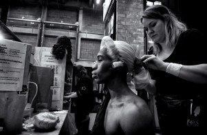 Wigs Manager Harriet Rogers puts on dancer Mlindi Kulashe's wig. Photograph by Simon Lee (3)