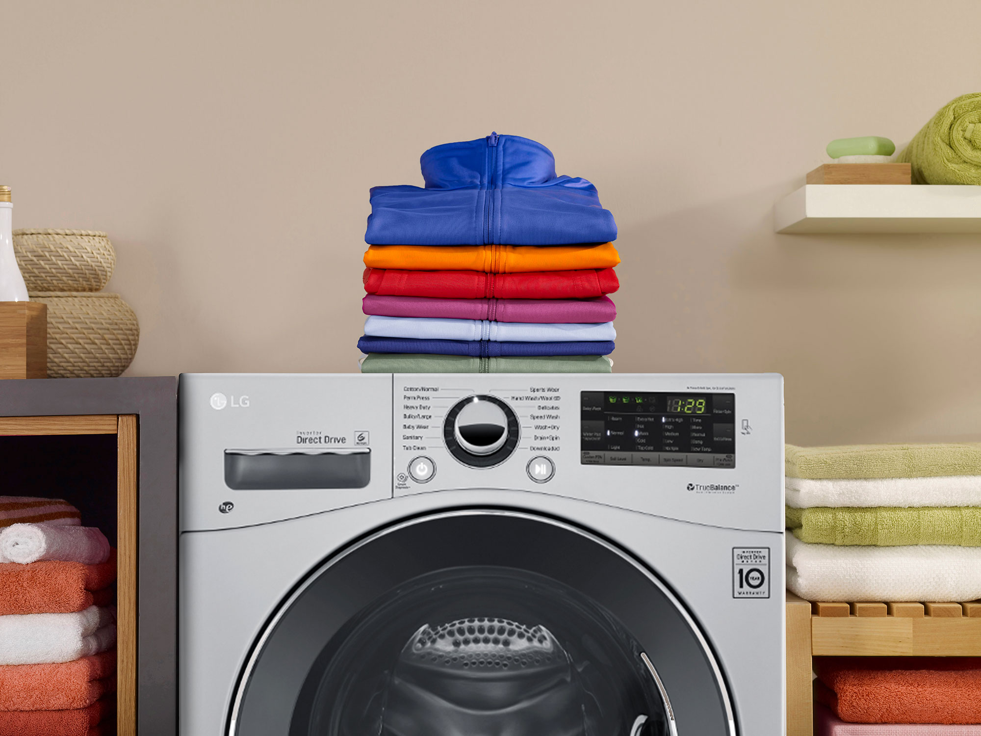 clothes folded on top of washer