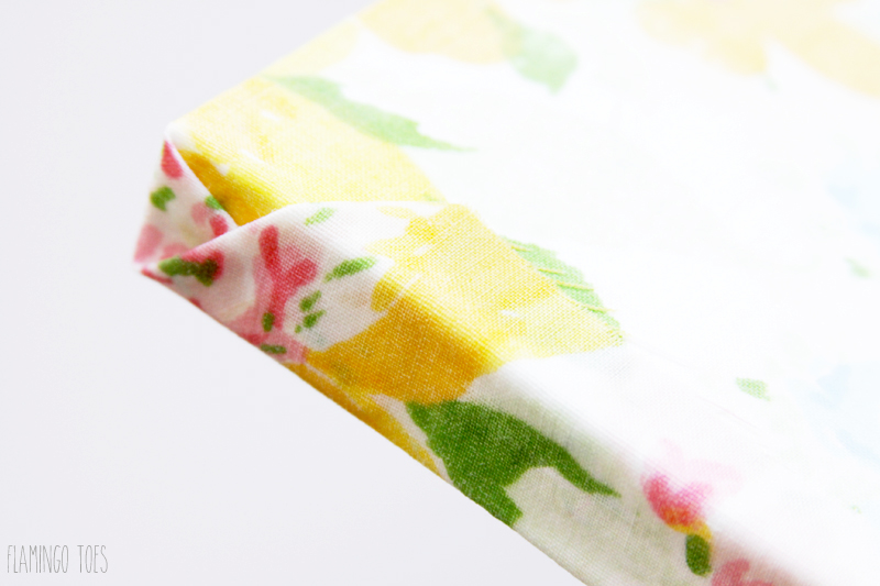 Envelope Fold on edge of fabric shelf