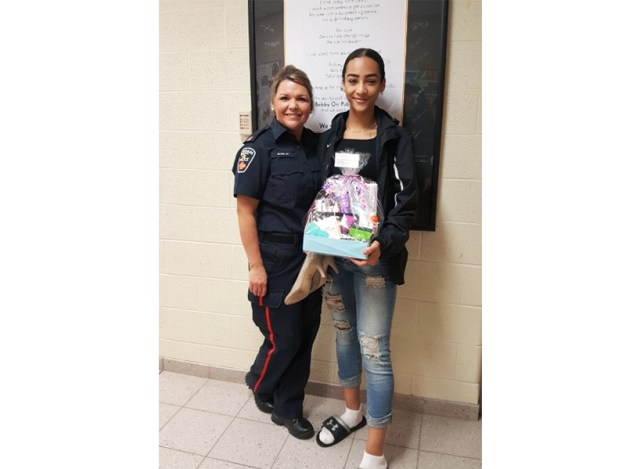 Police officer Joylene MacNeil standing with a student