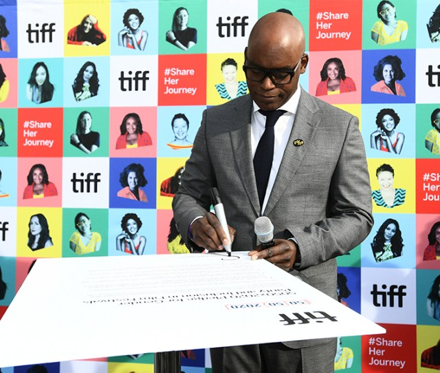 Tiff Artistic Director Co Head Cameron Bailey Signs The 50x Pledge Before