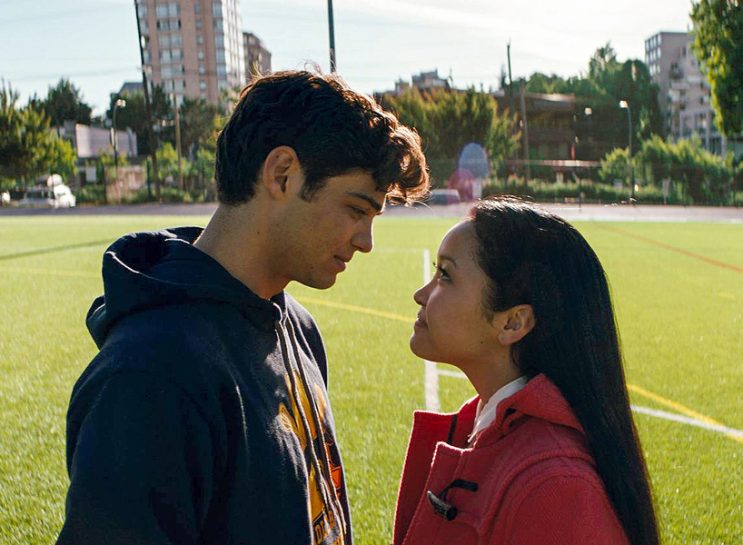 To All the Boys I've Loved Before sequel: Noah Centineo in blue hoodie and Lana Condor in pink jacket look at each other in a still from To All The Boys I Loved Before — The Yakult scene from the movie boosted the drink's sales
