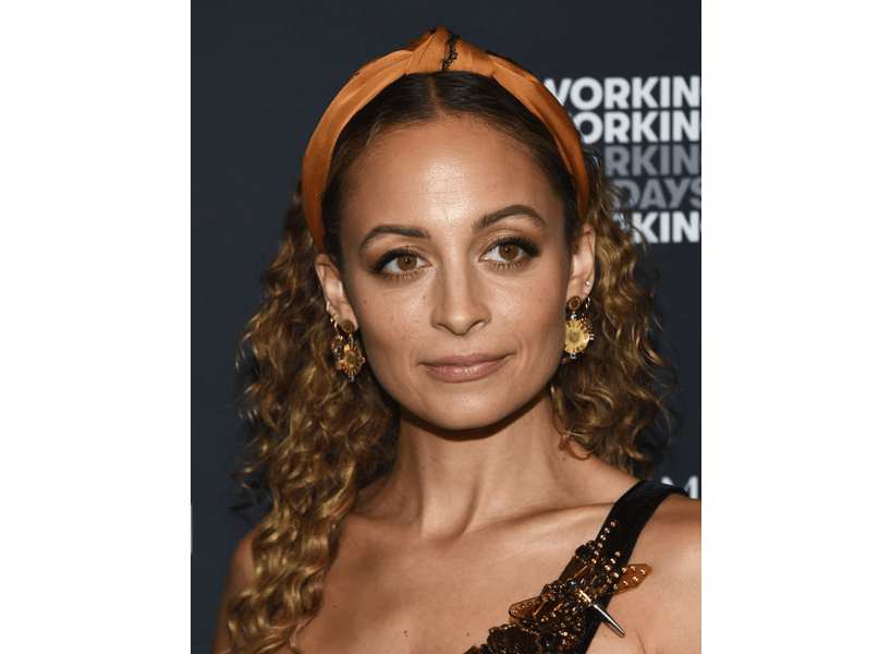 2020 hair trends: Nicole Riche in a silky orange headband.