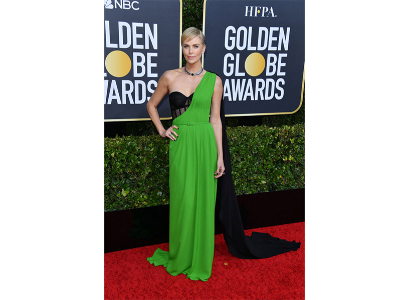 Charlize Theron wears a black and green dress on the Golden Globes 2020 red carpet