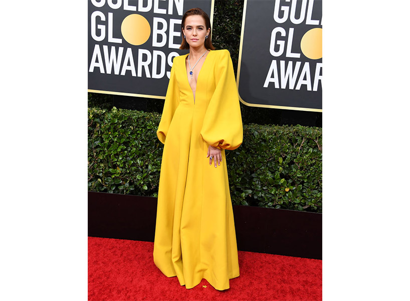 Zoey Deutch wears a yellow jumpsuit on the Golden Globes 2020 red carpet