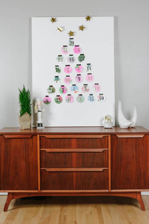 Up-cyle children's artwork to make a unique advent calendar.