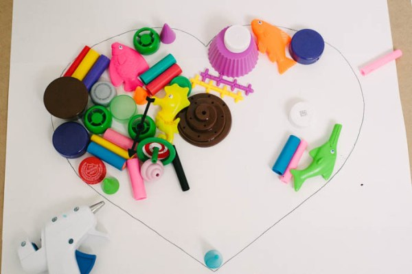 Get rid of missing game pieces, marker caps, and random toys. Organize and recycle toys with this simple heart art kids project.