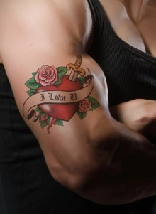 muscular arm with heart tattoo