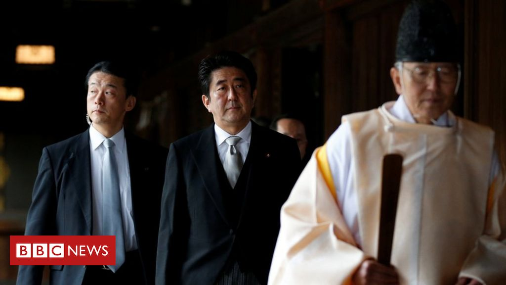 Japan's ex-PM Abe visits controversial war shrine