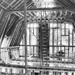 black and white photo of the granary undergoing structural restoration in the 1970s