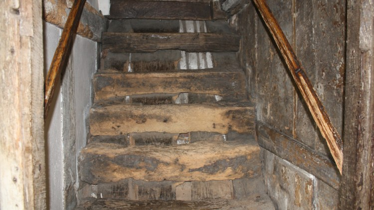 Photo of ancient log staircase in Valley Farm