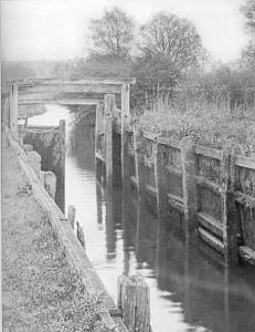 Black and white photo of Flatford Lock with wooden sides