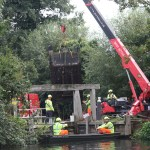 Photo of old oak gates being craned out of the lock at Flatford - 2014
