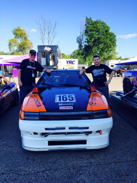 Eric Thompson (right) after winning one of two Hard Charger Awards at the 2016 SCCA Runoffs in his wild Celica!