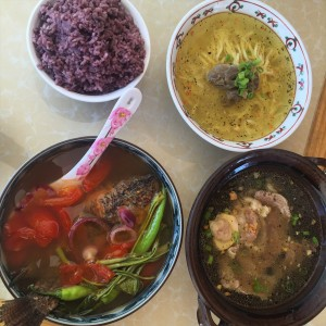 hearty lunch of red rice, sinigang na tilapia, bulalo , and mami