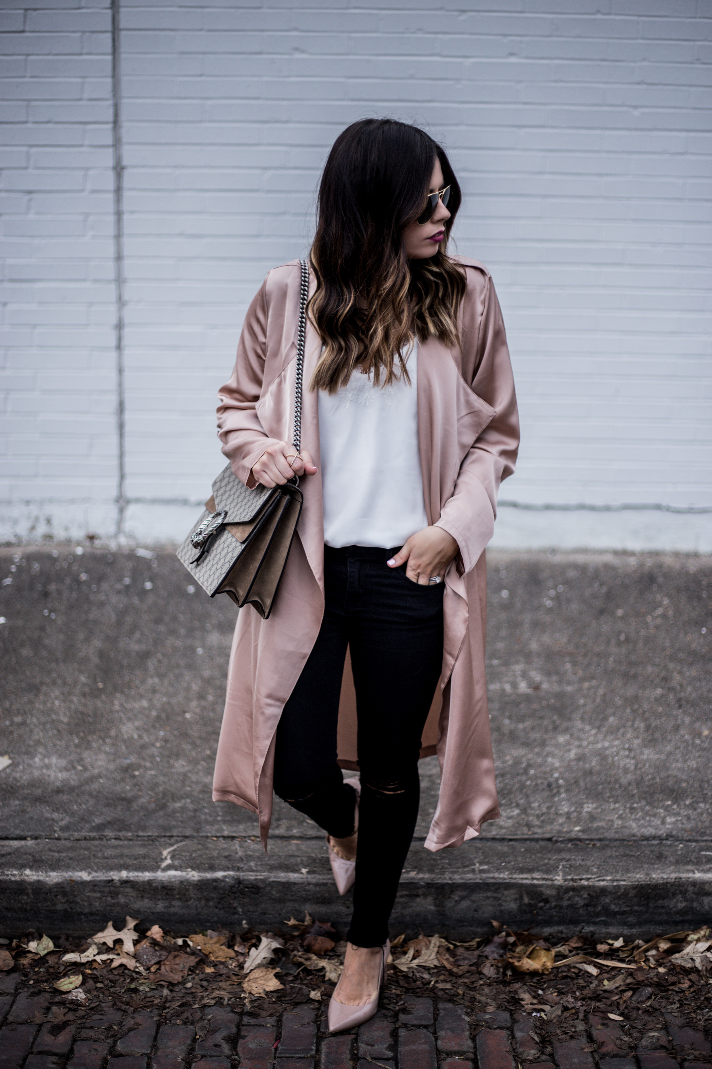 Lifestyle blogger Tiffany Jais of Flaunt and Center wearing a Satin blush duster paired with black distressed skinny jeans | what's currently trending in women's fashion 2016