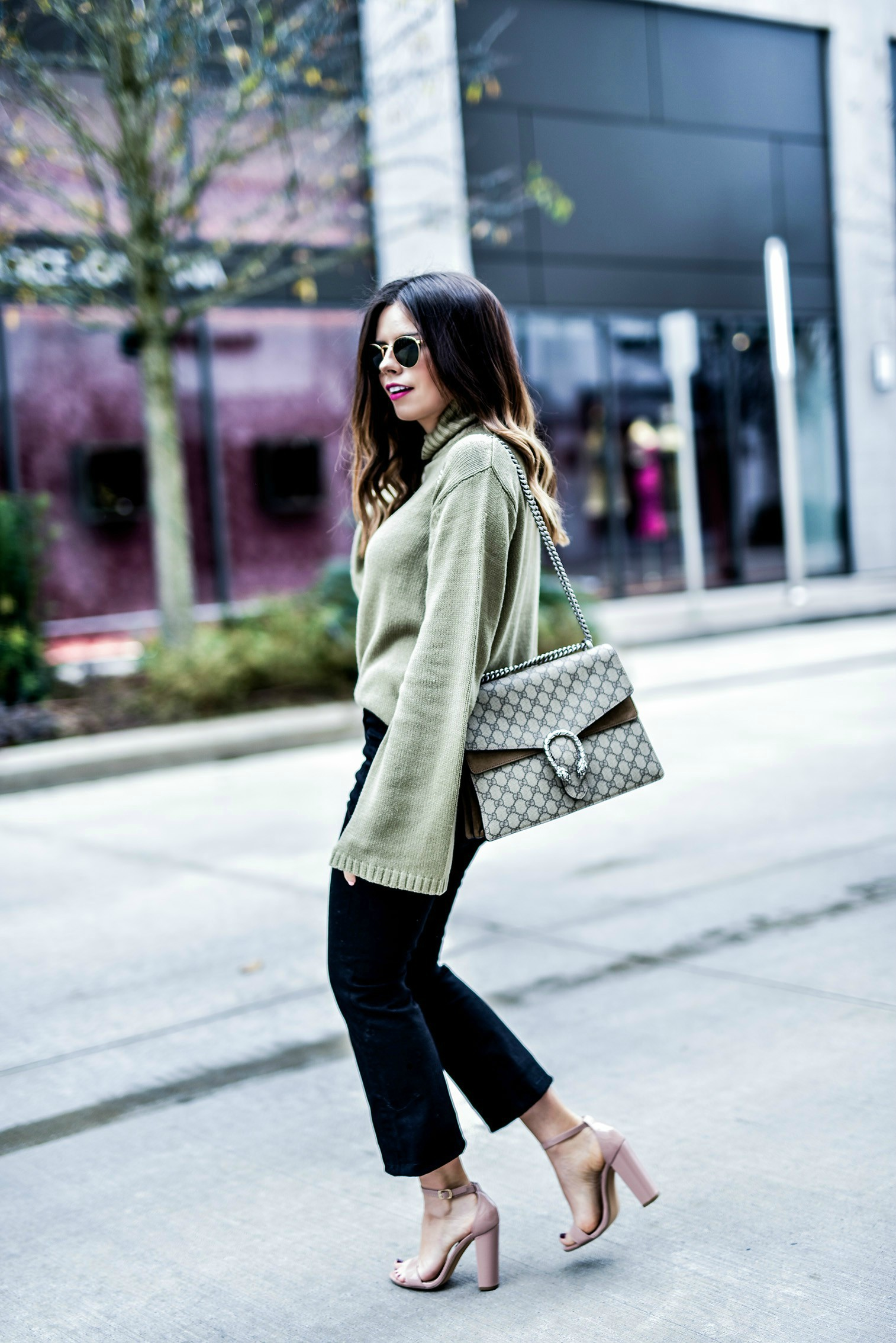 Tiffany Jais Houston fashion and lifestyle blogger sharing 3 closet must haves | Wearing a bell sleeve sweater in olive, and black denim flare cropped jeans | Gucci Dionysus bag, what's trending