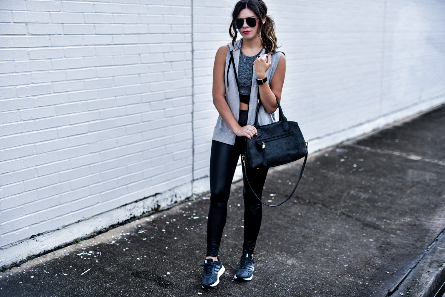Houston fashion and lifestyle blogger Tiffany Jais wearing beyond yoga activewear, click to read more | Beyond yoga vest, high gloss leggings, beyond yoga sports bra |