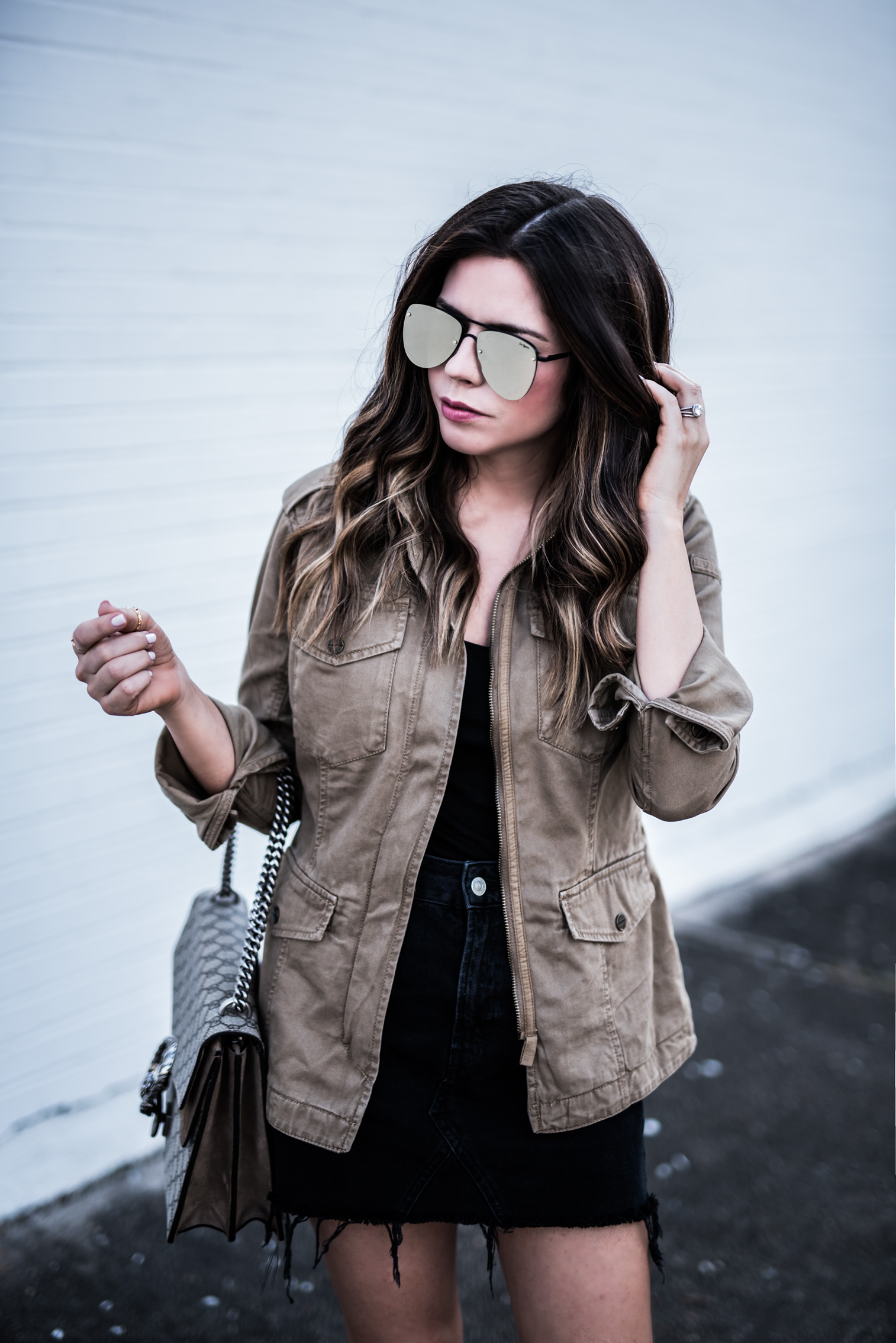Houston fashion blogger wearing a black denim moto skirt, chloe boots, and mirrored sunglasses, click to shop the look   Outfit ideas for school, women's fashion, cute outfits for spring,