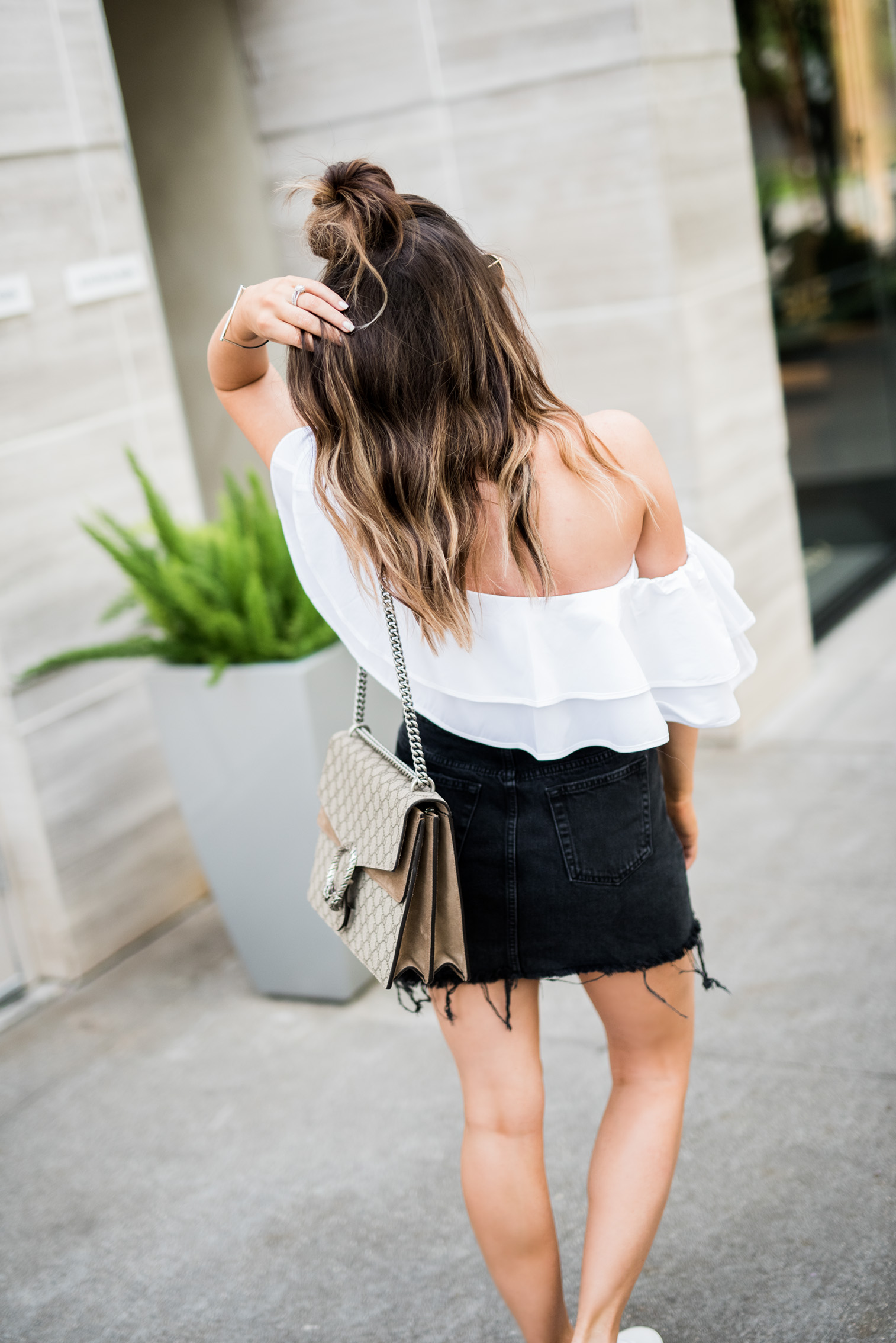 Tiffany Jais Houston fashion and lifestyle blogger | Ruffles | Embroidered sneakers, Gucci Dionysus bag, Ruffle top, Black denim skirt, casual outfit ideas, street style