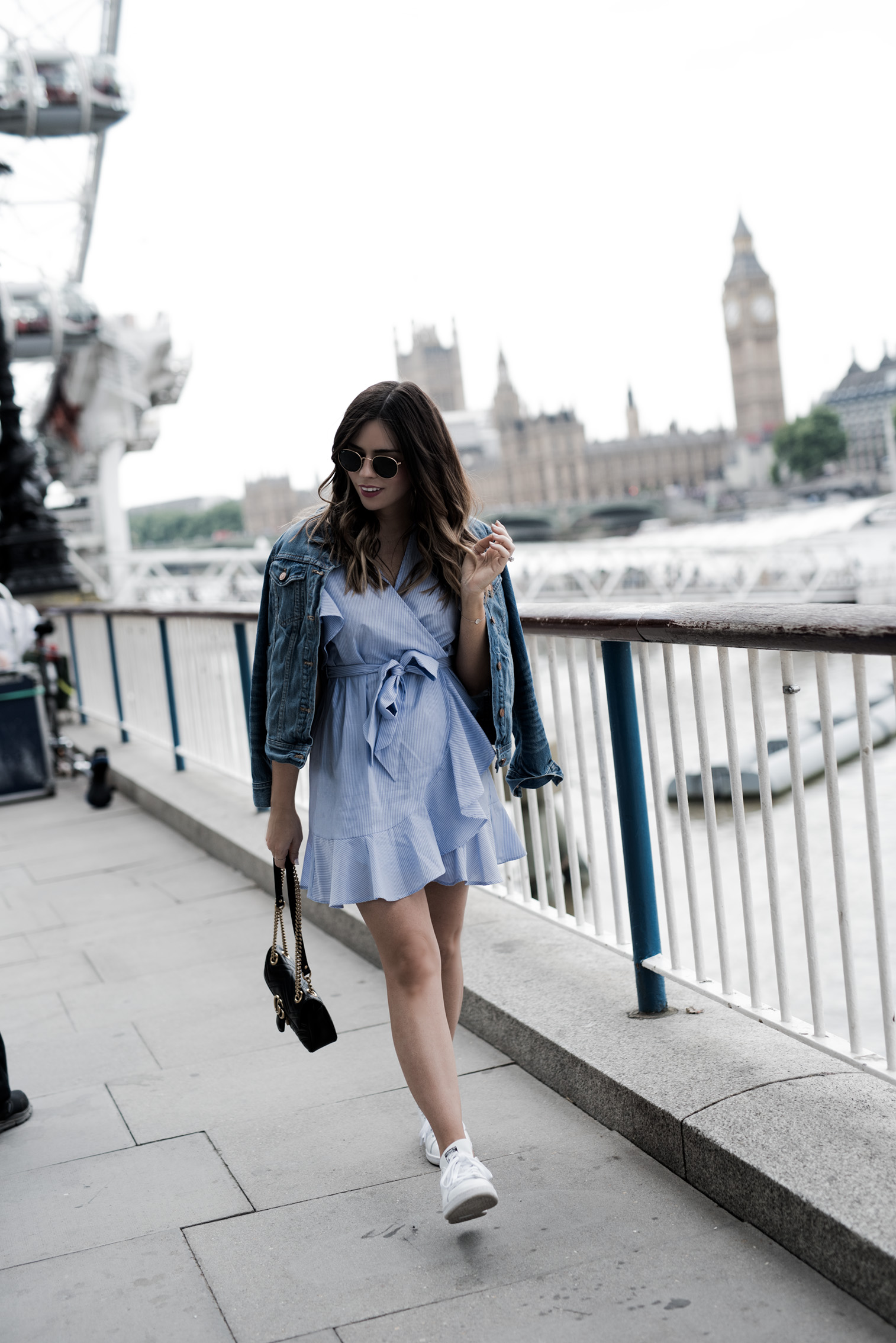 Tiffany Jais Houston fashion and lifestyle blogger | The London eye-what I wore, Gucci marmot bag, wrap dress, dresses with sneakers outfits, casual outfits, what to wear in London, Things to do in London,