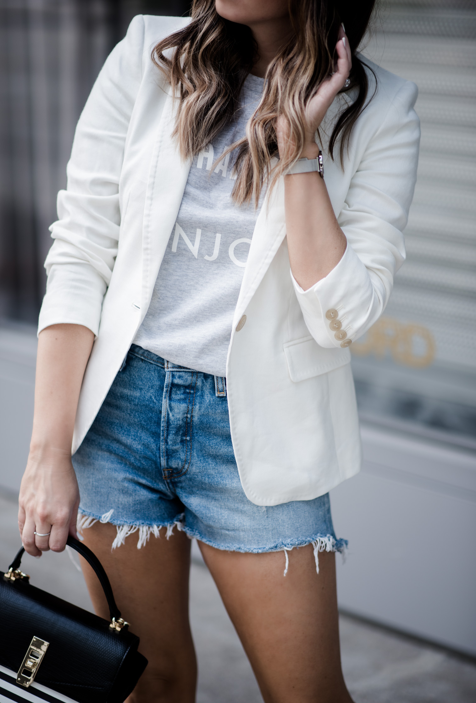 Tiffany Jais Houston fashion and lifestyle blogger | graphic tee outfits, how to wear a blazer with shorts, casual outfit ideas, blazer outfits,