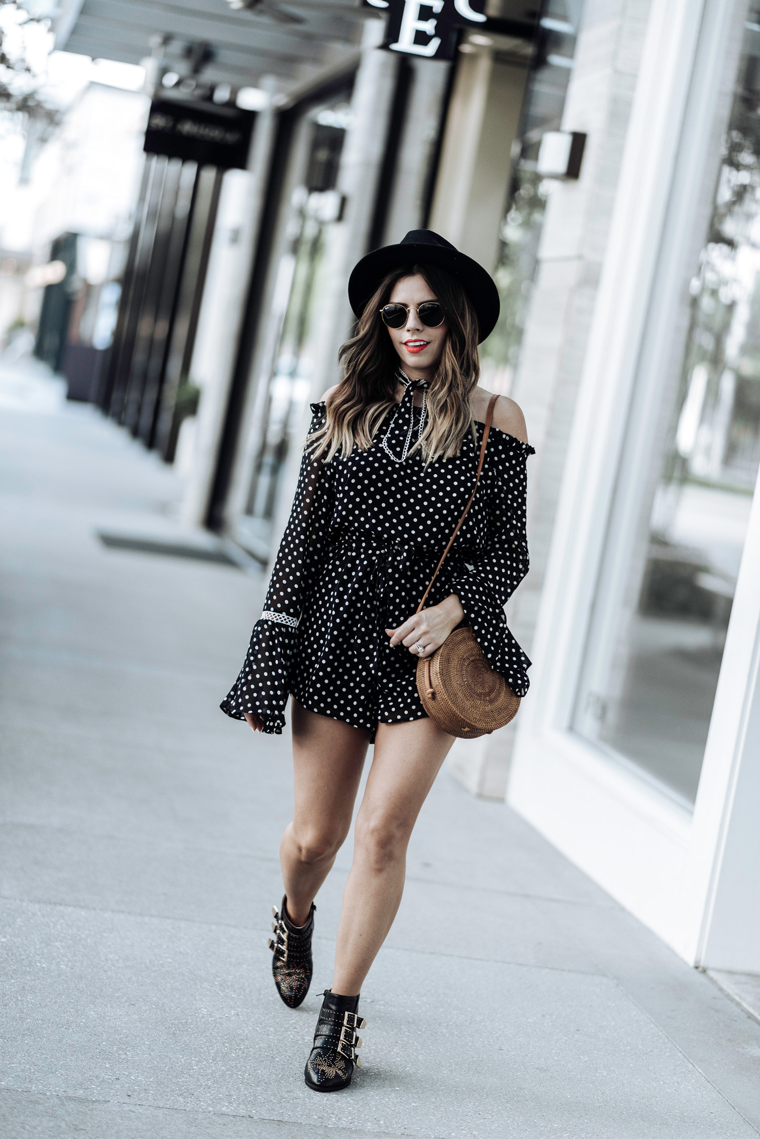 Tiffany Jais Houston fashion and lifestyle blogger | polka dot romper | round rattan bag, chloe studded boots, brixton hat