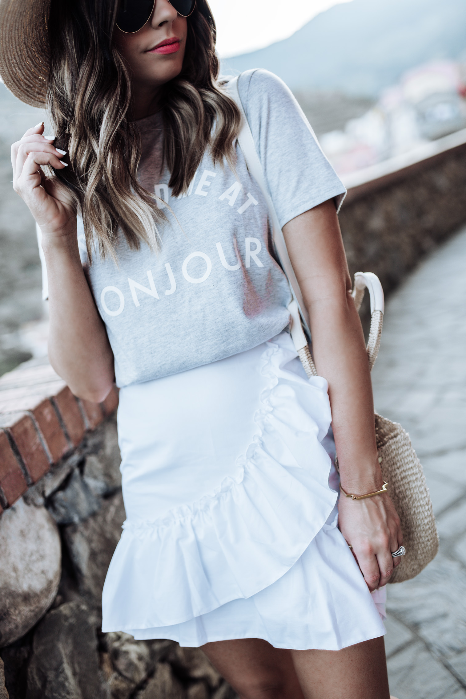 Tiffany Jais Houston fashion and lifestyle blogger | Graphic Tee (runs small size up)  | White ruffle hem skirt | Claire V. Alice Tote | Ked's | Brixton Willow hat